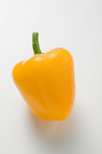 Yellow pepper with drops of water : Stock Photo