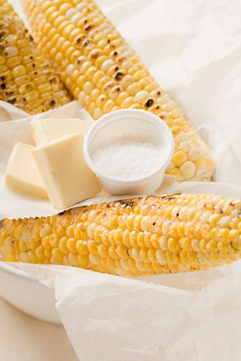 Grilled corn on the cob with salt and pieces of butter : Stock Photo