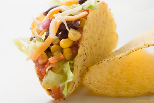 Taco filled with sweetcorn and beans : Stock Photo