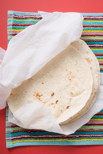 Freshly-baked tortillas on kitchen roll (Mexico) : Stock Photo