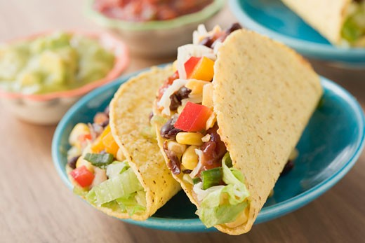 Vegetable tacos, dips in background (Mexico) : Stock Photo