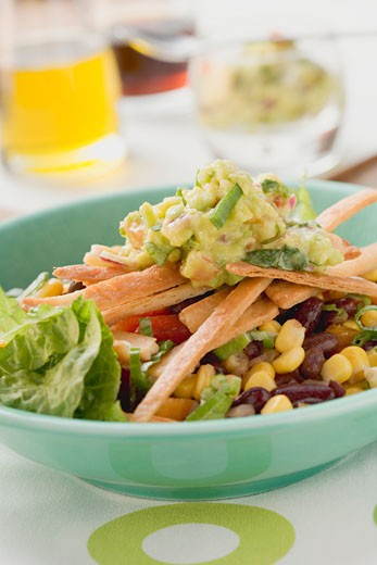 Stock Photo: 1532R-40810 Lettuce, beans, sweetcorn, tortilla strips and guacamole