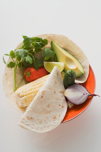 Stock Photo: 1532R-40818 Ingredients for Mexican dishes on plate (overhead view)