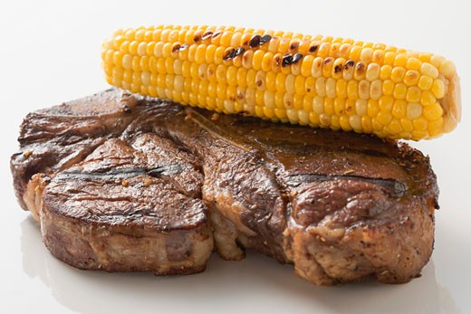 Grilled beef steak with corn on the cob : Stock Photo
