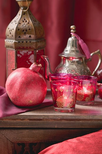 Stock Photo: 1532R-41055 Middle Eastern decorations: pomegranate, windlights, teapot