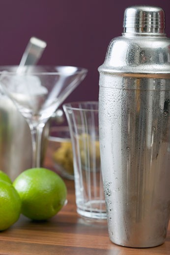 Stock Photo: 1532R-41129 Cocktail shaker, glasses and limes
