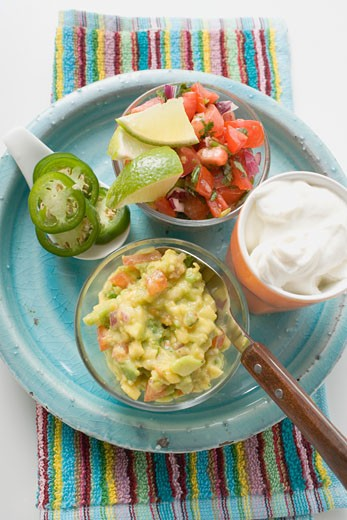 Guacamole, salsa and sour cream on plate (Mexico) : Stock Photo