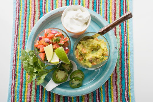 Stock Photo: 1532R-41465 Guacamole, salsa and sour cream on plate (Mexico)