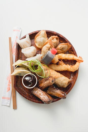 Plate of Asian appetisers to take away : Stock Photo