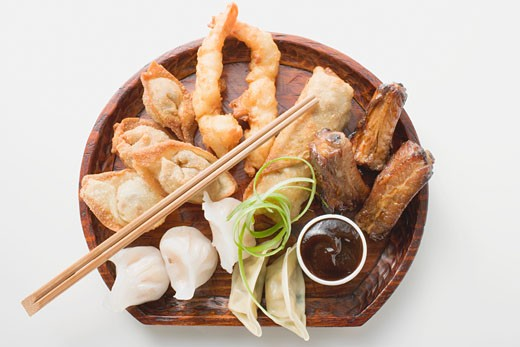 Plate of Asian appetisers with dip : Stock Photo