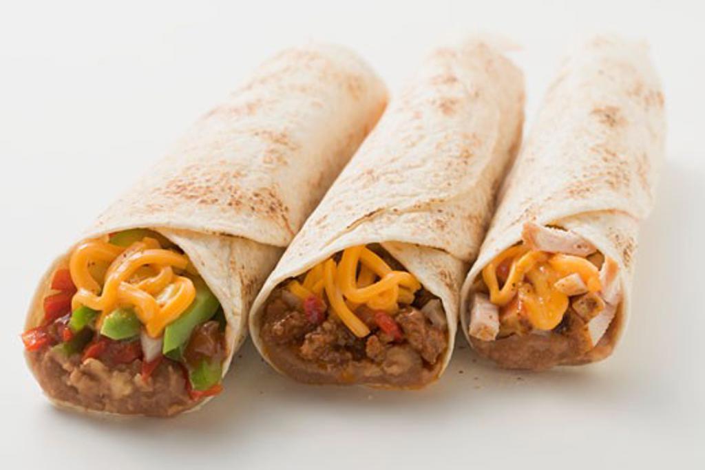 Three different burritos : Stock Photo