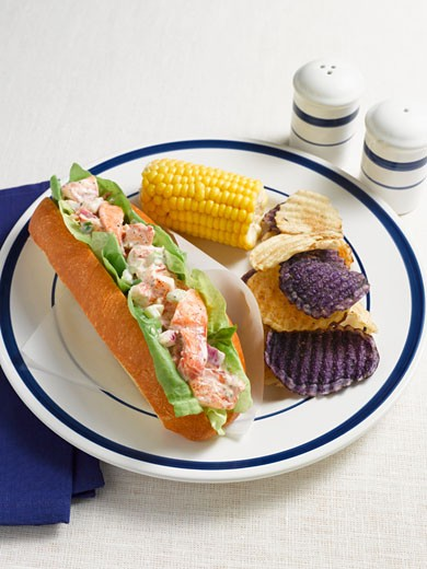 Stock Photo: 1532R-42480 Lobster Roll with Potato Chips and Corn
