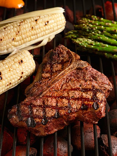 Porterhouse Steak on the Grill with Corn and Asparagus : Stock Photo