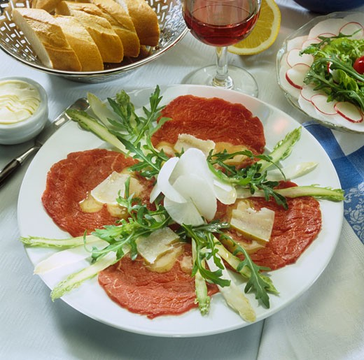 Beef carpaccio with asparagus and rocket : Stock Photo