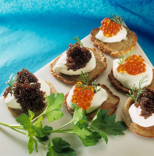 Blinis with sour cream and caviar : Stock Photo