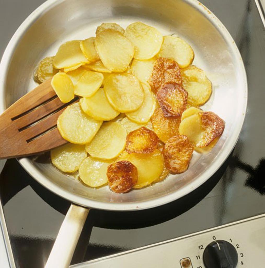 Fried potatoes (Frying potatoes in frying pan) : Stock Photo