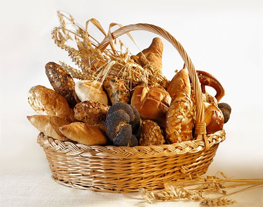 Assorted bread rolls, breads & cereal ears in bread basket : Stock Photo