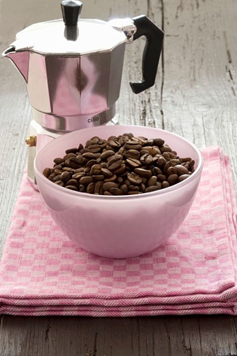 Espresso pot with a small bowl of espresso beans : Stock Photo