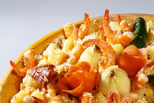 Rice dish with shrimps and onions : Stock Photo