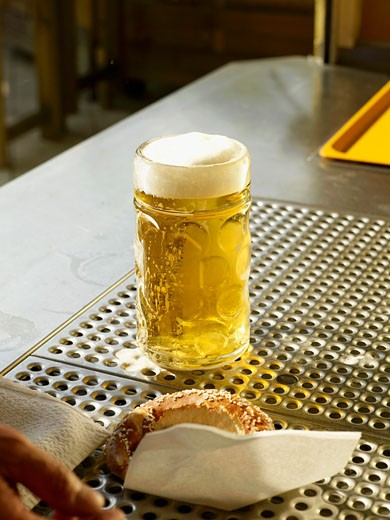 Stock Photo: 1532R-44727 Freshly poured draught beer on bar counter