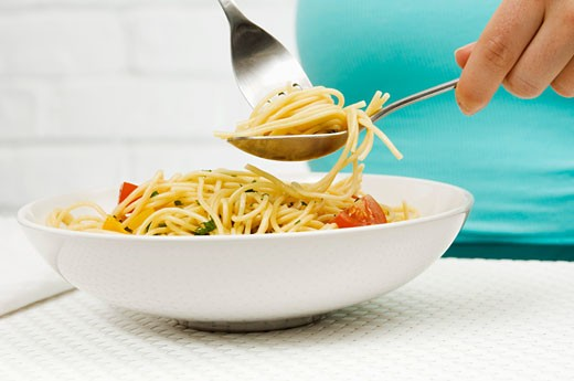 Eating spaghetti : Stock Photo
