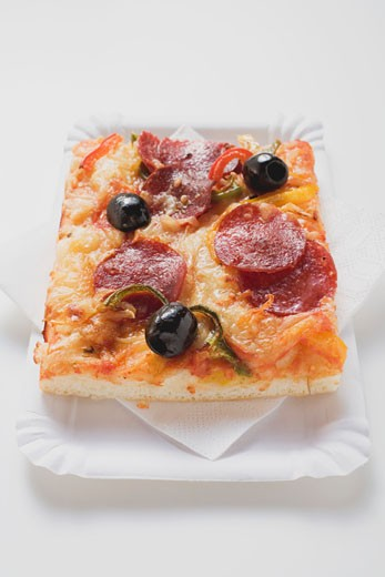 Stock Photo: 1532R-45858 Slice of pepperoni pizza with peppers and olives