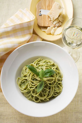 Spaghetti with pesto, Parmesan and glass of white wine : Stock Photo