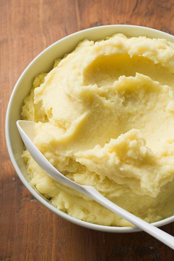 Mashed potato in white bowl with spoon : Stock Photo