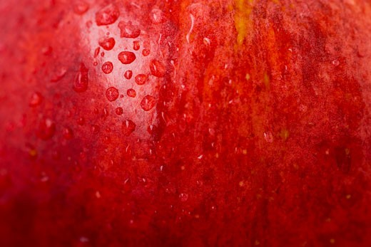 Red apple with drops of water (detail) : Stock Photo