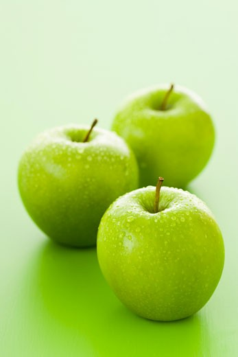 Three Granny Smith apples with drops of water : Stock Photo