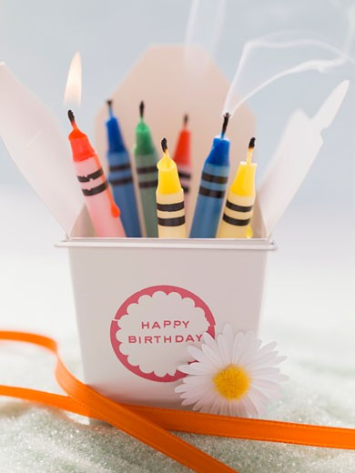 Crayon candles for a birthday : Stock Photo