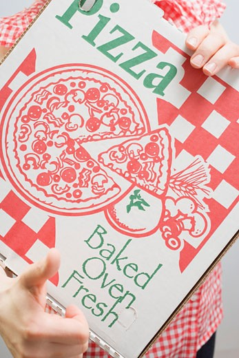Woman holding pizza box (close-up) : Stock Photo