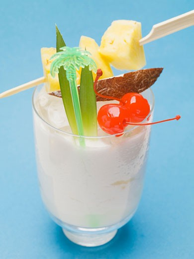 Piña Colada with pineapple skewer and cocktail cherries : Stock Photo