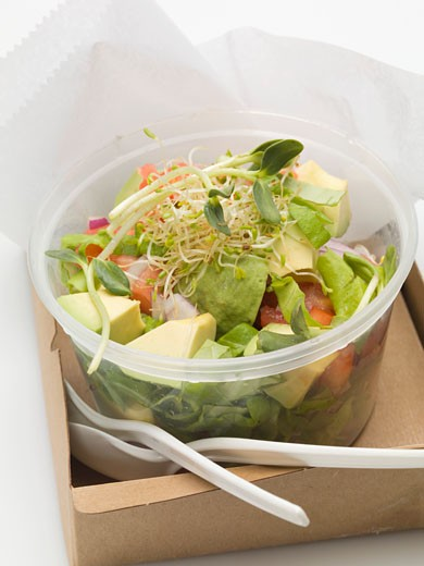 Avocado salad with sprouts in plastic container to take away : Stock Photo