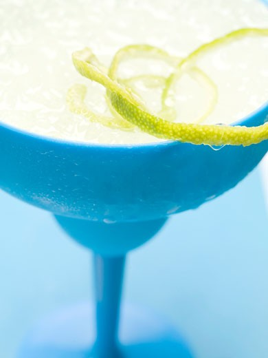 Frozen Margarita with lime zest in blue glass : Stock Photo