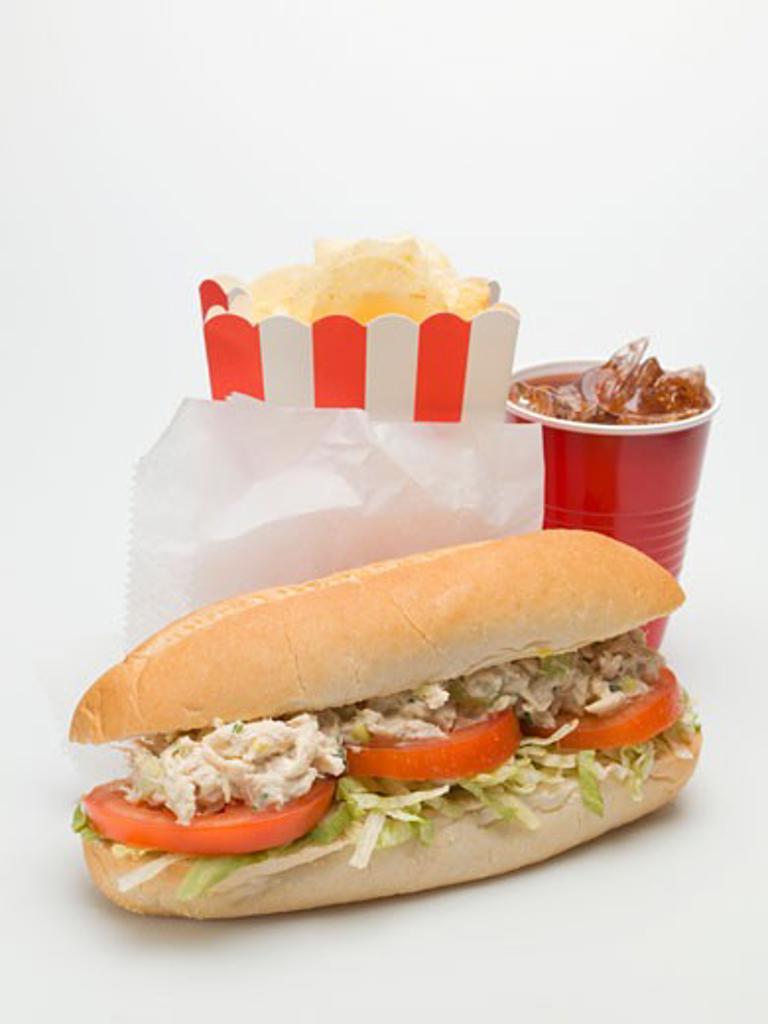 Tuna and tomato sandwich, crisps, cola : Stock Photo