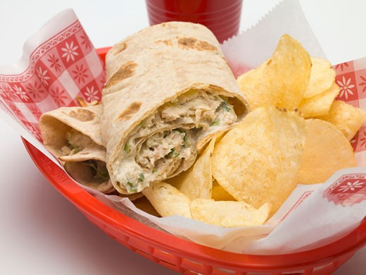 Wrap with crisps in a plastic basket : Stock Photo