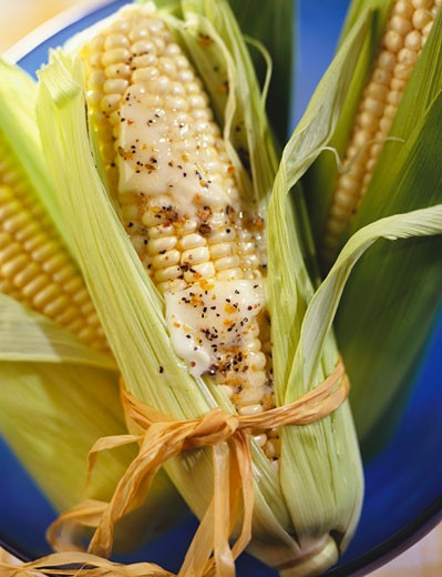 Corn on the Cob with Butter in Husk : Stock Photo