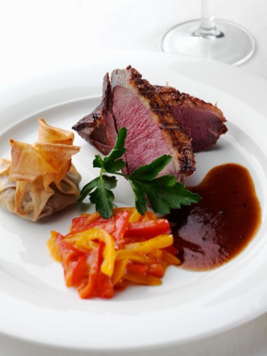 Sliced Duck Breast with Dumpling and Peppers : Stock Photo