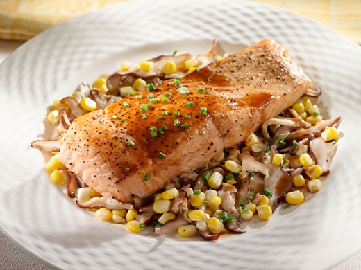 Salmon Fillet Over Corn and Mushroom Saute : Stock Photo