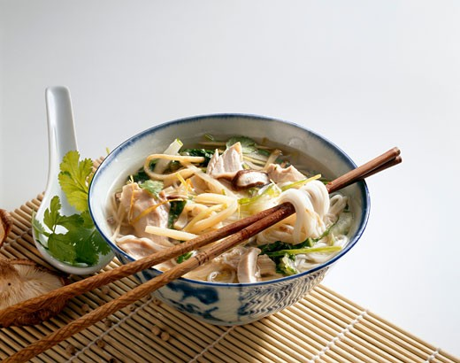 Chinese chicken soup with noodles : Stock Photo