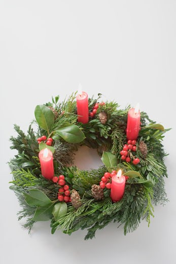 Advent wreath with four burning candles : Stock Photo