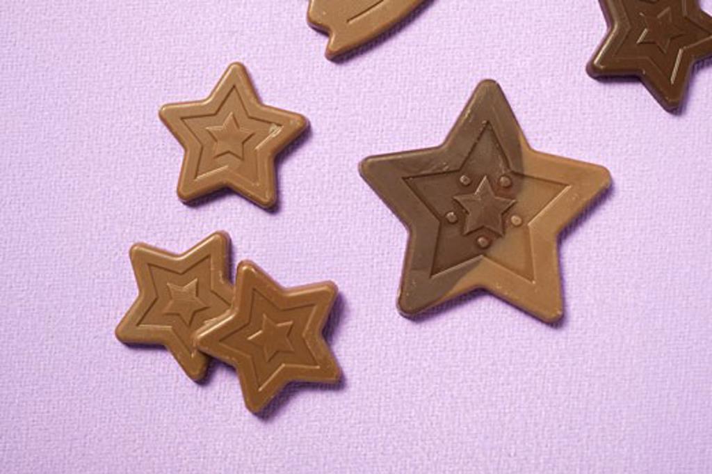 Chocolate stars on purple background : Stock Photo