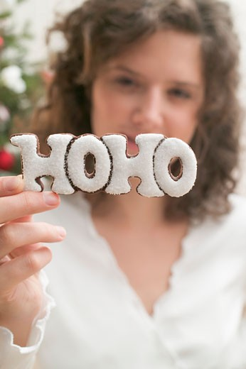 Woman holding biscuit (the word HOHO) : Stock Photo