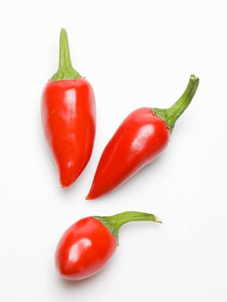 Stock Photo: 1532R-50309 Three red chillies