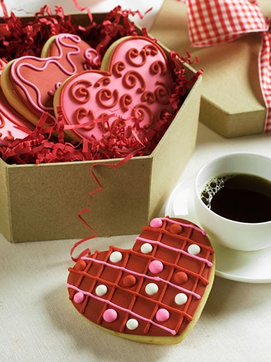 Box of Decorated Heart Cookies For Valentine's Day; One with Coffee : Stock Photo