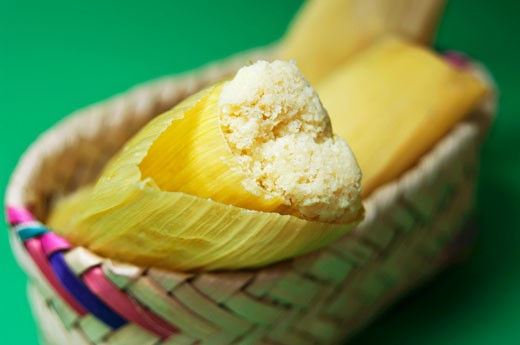 Tamales (Stuffed maize leaves, South America) : Stock Photo