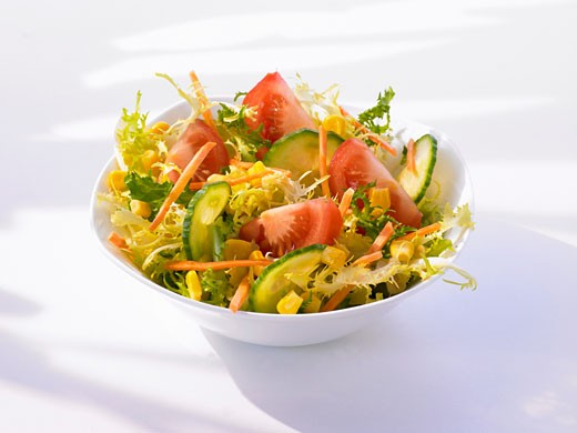 Frisée with cucumber, tomato, sweetcorn and carrot : Stock Photo