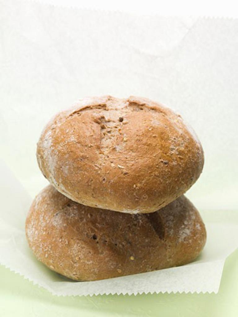 Two crusty brown rye rolls : Stock Photo