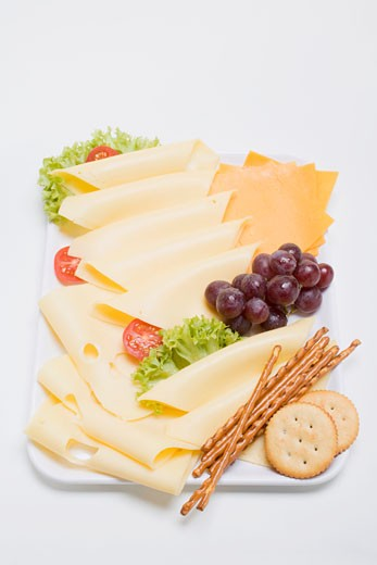 Cheese platter with grapes and nibbles : Stock Photo